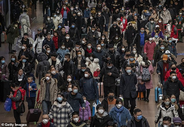 The Chinese government has attempted to be transparent about the new coronavirus outbreak, but citizens are wary, remembering cover-up of the SARS epidemic from 2002 to 2004. Pictured: Chinese passengers, most wearing masks, arrive to board trains before the annual Spring Festival at a Beijing railway station, Thursday