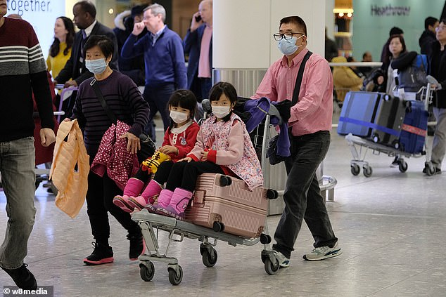 Passengers arriving at Terminal 3 on flights from China wore masks to protect them from possible infection
