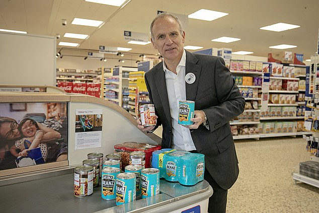 Chief executive Dave Lewishas pledged to remove one billion pieces of plastic from own-brand goods by this year. He is pictured above at a Tesco store holding the single tins