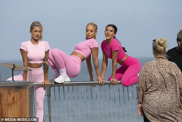 Three's a crowd: The models then joined Tammy for the sultry snap, as they balanced their bodies on the barrier