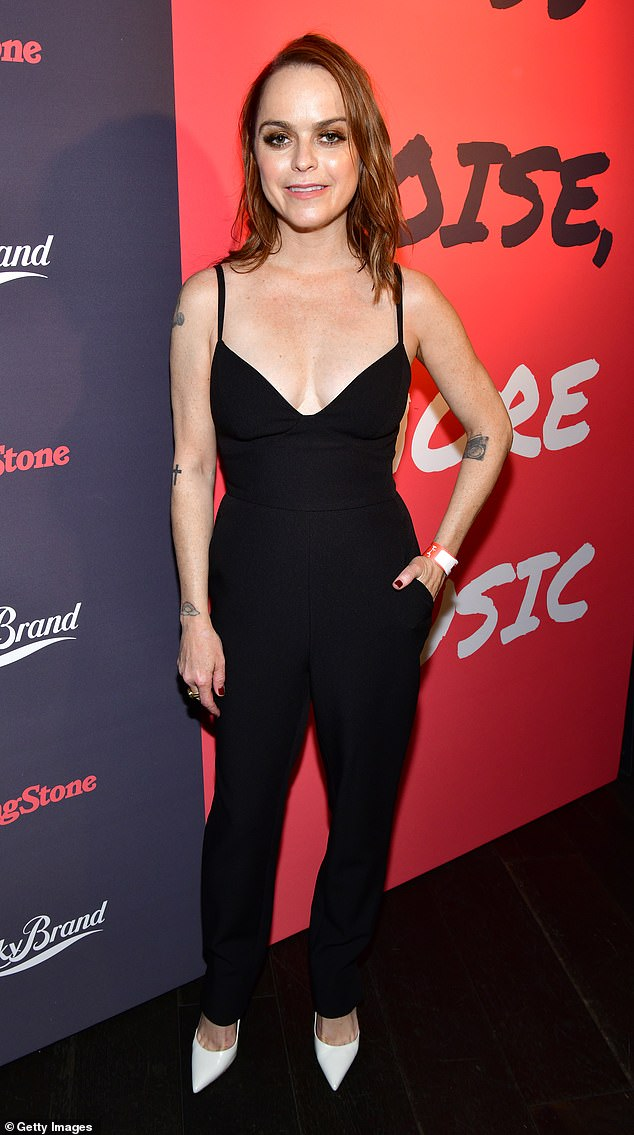 Lady in black:Adding to the star appeal of the event, Taryn Manning, 41, glammed up in a sexy black jumpsuit with spaghetti straps and a plunging front