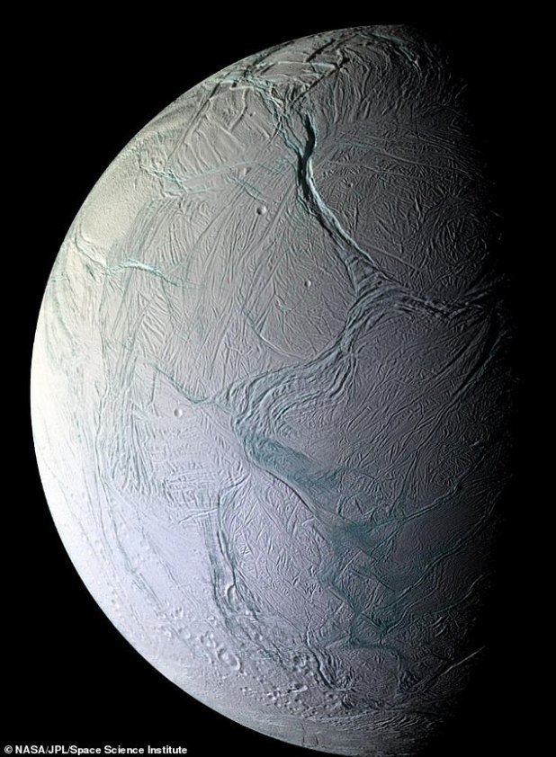 Enceladus (in NASA's Cassini satellite image) is the sixth largest of Saturn's moons, with a diameter of about 310 miles.  The moon is covered in a glistening layer of clean ice, making it one of the most reflective bodies in the Solar System.