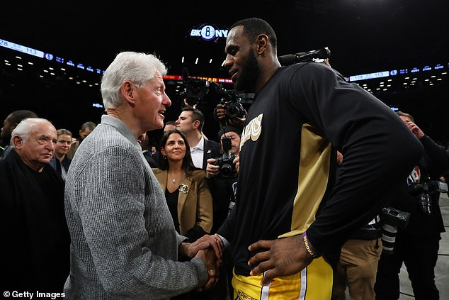 Le Bron James, seen shaking hands with Mr Clinton, said the former president, alongside his successor, Barack Obama, were two men he admired