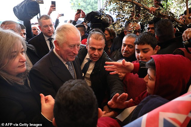 Prince Charles (L) visits the compound of the Church of the Nativity