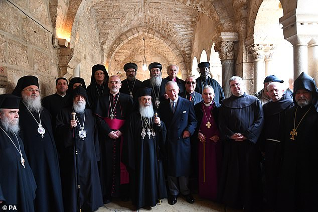 The Prince of Wales (centre) during a visit to the Church of the Nativity in Bethlehem on the second day of his visit to Israel and the occupied Palestinian territories