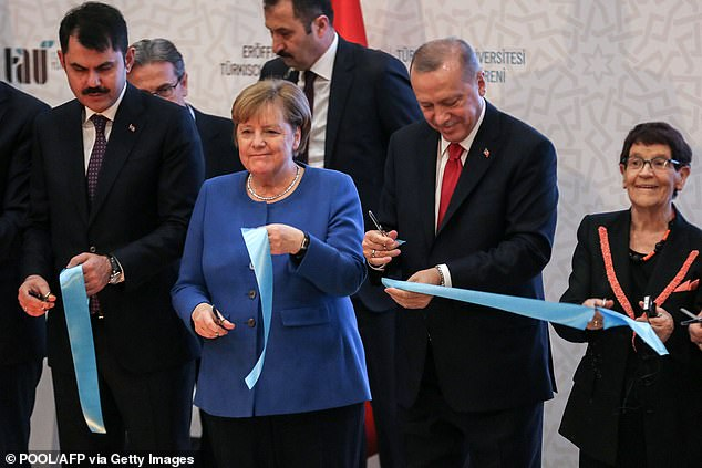 Merkel and Erdogan cut ribbon for the opening ceremony ofthe Turkish-German University's new facilities in Istanbul