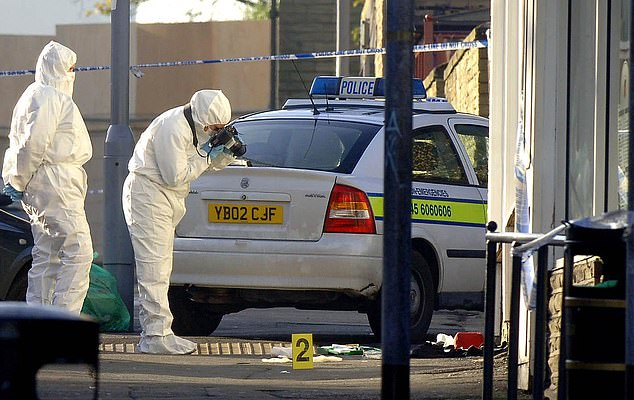 Forensic investigators are pictured at the scene of PC Beshenivsky's murder in Bradford in 2005