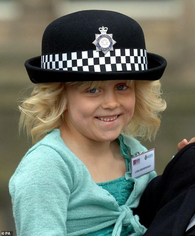 Lydia Beshenivsky, five, the daughter of murdered WPC Sharon Beshenivsky waits to present flowers to the Queen in Bradford in 2005