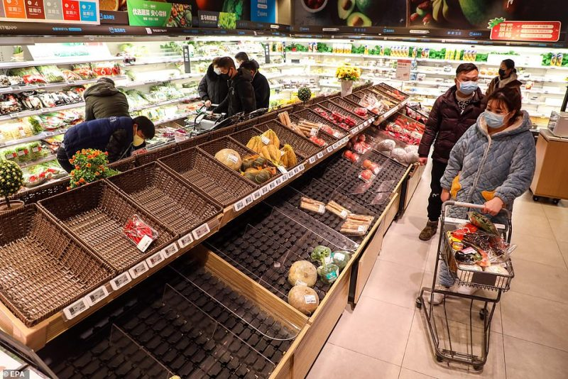 Supermarket shelves have been swiped clean following a spike in panic buying as the city goes into lock down