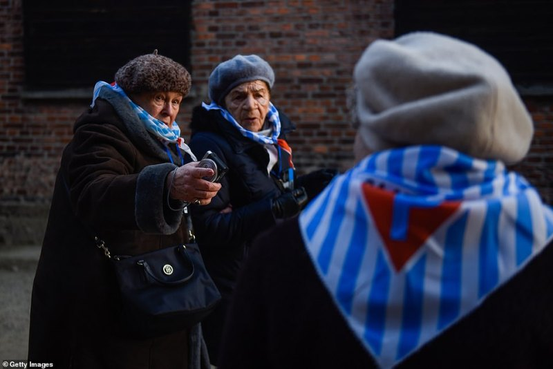 Many of the survivors wore striped scarves, which are reminiscent of the uniforms they were made to wear while inside the concentration camps, as they arrived to mark the 75th anniversary of the camp's liberation