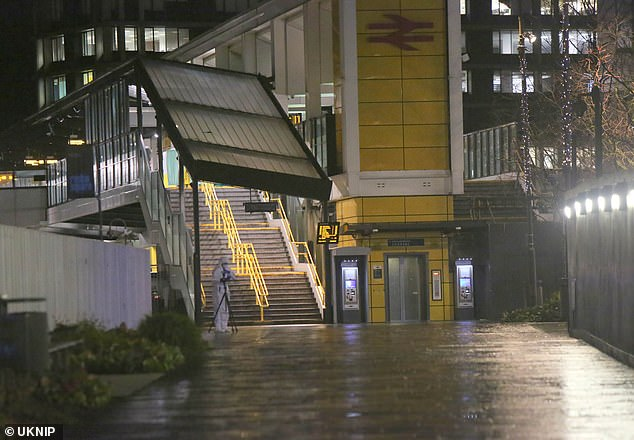 A forensics officer at the scene at East Croydon station on Monday evening after a young man was stabbed to death