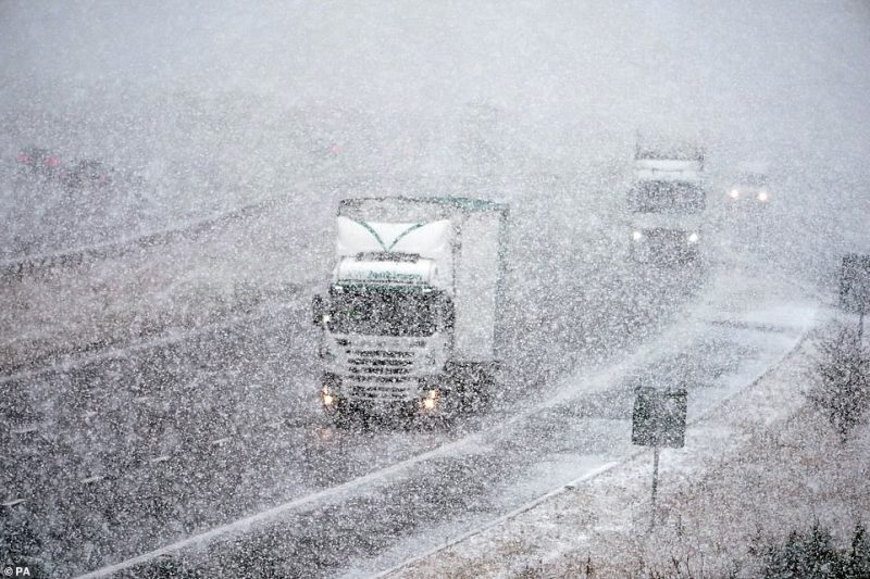 Traffic travels along the M6 near Shap in Cumbria during a blizzard as snow settles on the ground after it was forecast for the highlands and high-level areas