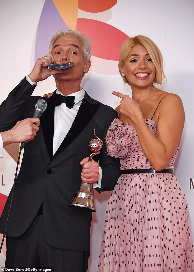 Over the moon: Last year, Holly and Phil celebrated their win for Best Daytime in spectacular fashion, as they downed from a hip flask backstage (pictured)
