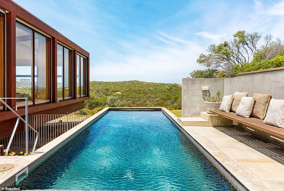 The former owner of electronics retailer JB Hi-Fi Richard Bouris has offered a look inside his stunning neighbouring holiday homes in Portsea on the Mornington Peninsula (No 16 home pictured)