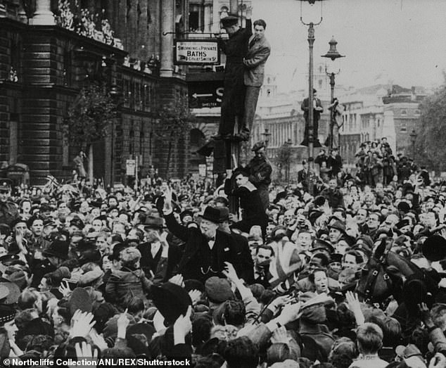 Sir Andrew Gregory, of the armed forces charity SSAFA, said 'bringing the nation together' to commemorate the date in world history is 'absolutely fitting'. Pictured is Prime Minister Winston Churchill being mobbed after his VE Day broadcast