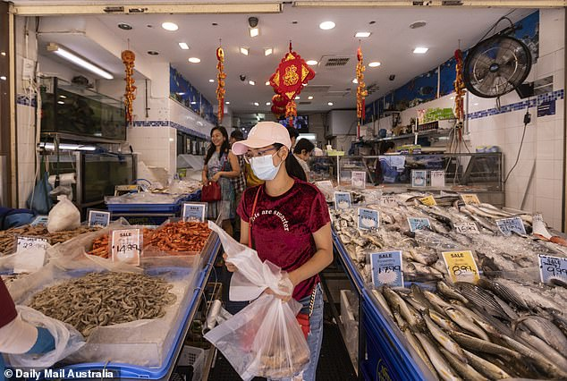 Authorities are closely watching key meeting places around the country for signs of outbreaks of coronavirus as the World Health Organisation declares a global public health emergency. Shoppers are pictured at a seafood market in Sydney's Cabramatta