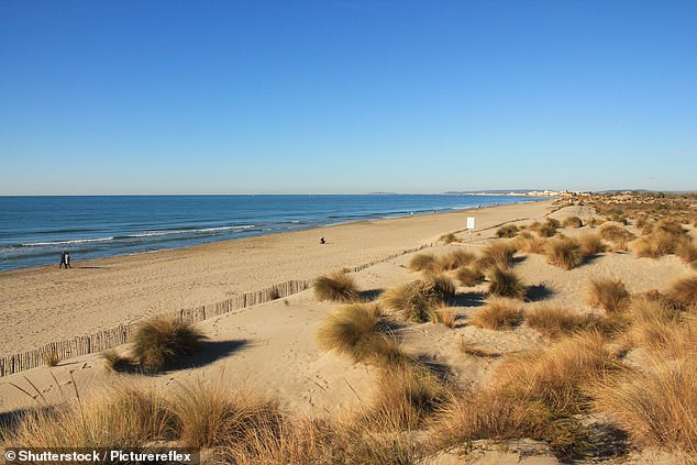 A golden sandy beach in the Camargue region in the south of France. To reach the Camargue, it is best to fly to Marseille