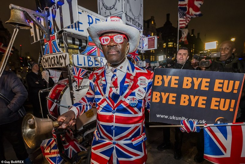 With just hours to go until the country leaves the European Union, Britons up and down the country are celebrating in style - with street parties and pub crawls to mark the historic occasion this evening. Pictured: A man dons a Union Jack suit to celebrate