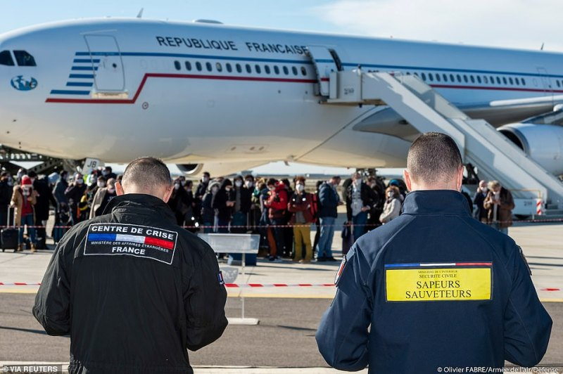 French nationals repatriated from Wuhan, China, amid the new coronavirus outbreak, get off the plane at Istres Air Base, near Marseille, France yesterday (images were released by French officials today)