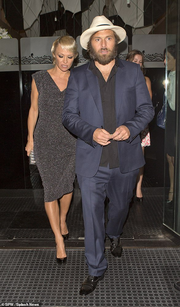 Pamela and Rick Salomon leave a Beverly Hills restaurant in 2010