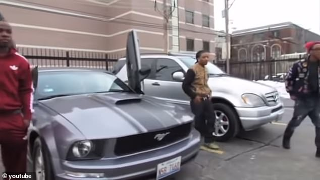 Aspiring rapper Qaw'mane Wilson of Chicago is pictured emerging from a Ford Mustang his mother bought him in a video he posted on YouTube. Wilson was sentenced to 99 years in prison after he and a hitman he hired to gun down his mother were found guilty of her murder