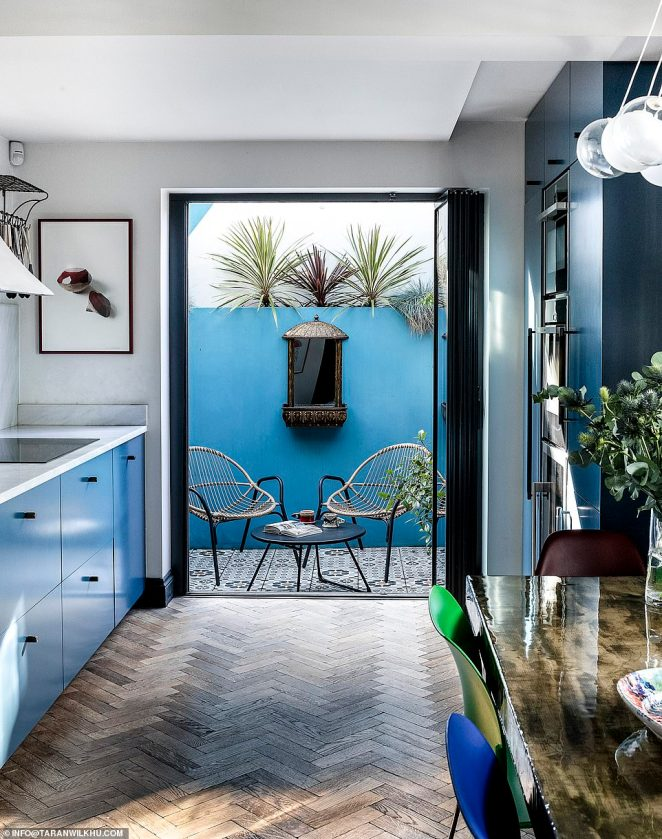 Even a Mediterranean-style patio, which only measures 1.5m by 3m, was made to look spacious after the couple painted every surface a bright colour and added large glass doors