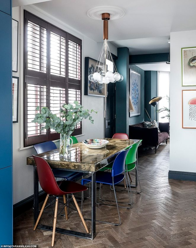 The couple kitted out their concrete dining table with an injecting of dye which was then coated in resin. The room also features stylish blue walls and colourful furnishings