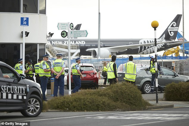Police about to escort buses transporting passengers off Wuhan flight to Whangaporoa Military Base from Auckland International Airport