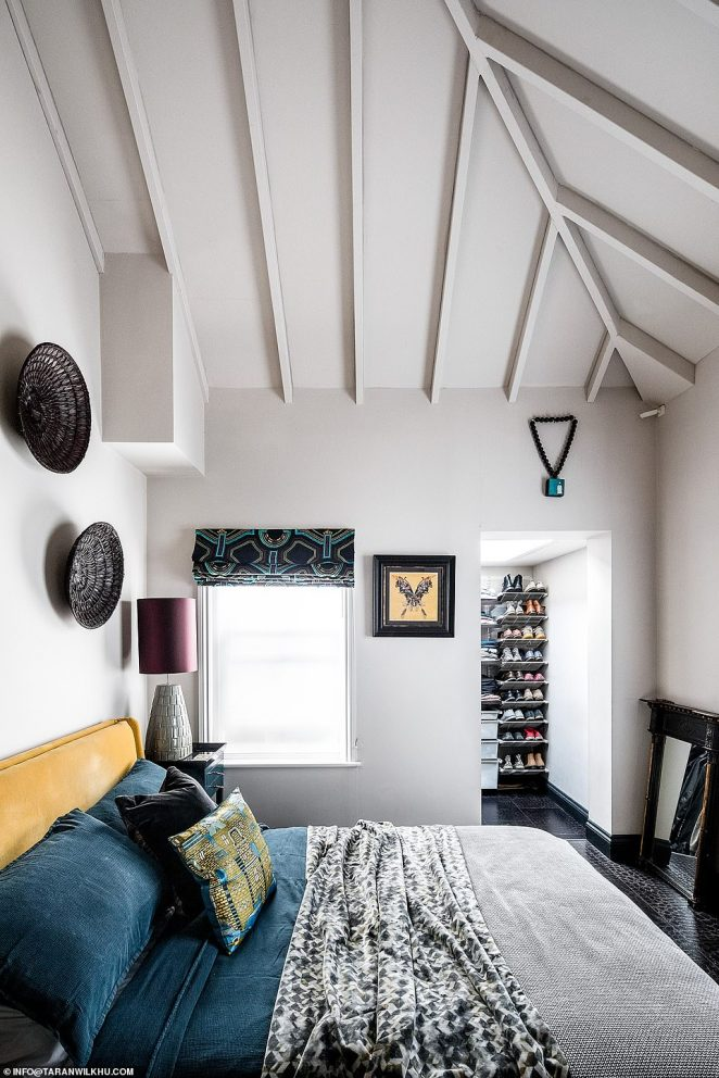 Taking a trip upstairs, a low-ceiling in the master bedroom was removed which allowed them to build a spare bedroom on a mezzanine level in the extra space