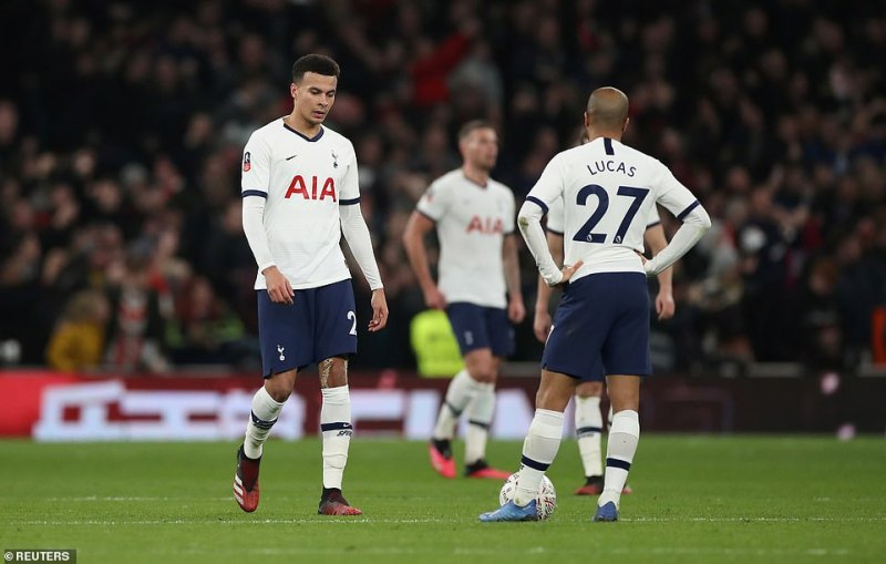 Alli and his team-mates react after Ings's strike had left them with plenty of work to do at the Tottenham Hotspur Stadium
