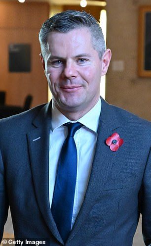Scottish finance Secretary Derek Mackay (pictured at Holyrood in October 2019), 42, allegedly contacted the boy, 16, out of the blue on Facebook and Instagram