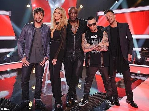 McMullen hosted The Voice from 2012 to 2015. He is pictured far left with season two judges (left to right) Delta Goodrem, Seal, Joel Madden and Ricky Martin