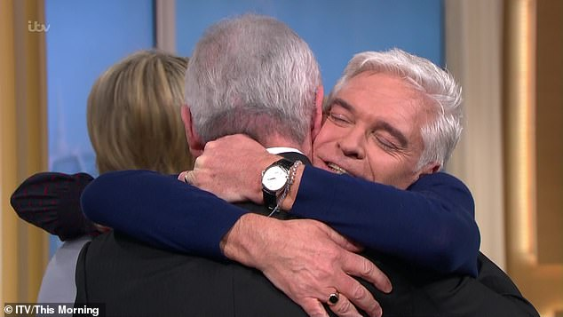 Much love: This Morning stand-in host Eamonn Holmes embraced Schofield following his interview