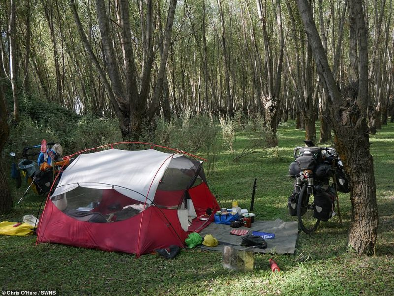 """The couple's tent is shown here in Uzbekistan.Chris said: """"We just pitch up wherever we want, which is much easier than trying to find a hostel or something like that"""""""
