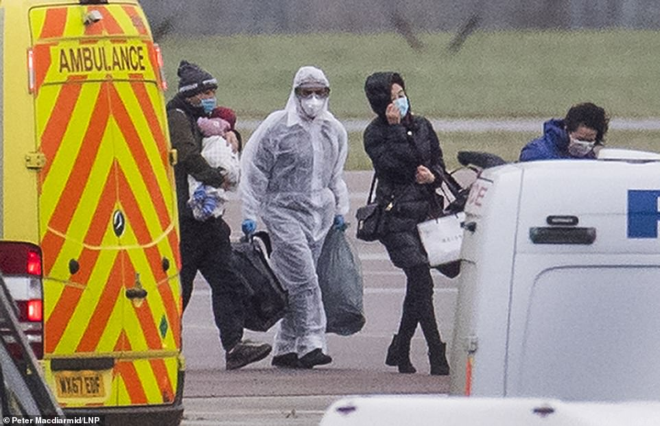 Passengers disembark from a charter flight carrying Britons evacuated from Wuhan , China after it arrived at RAF Brize Norton in Oxfordshire