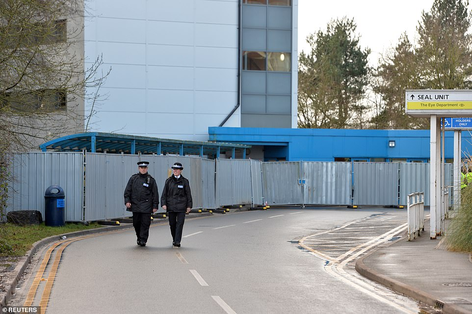 Police officers patrol the quarantined area outside Arrowe Park Hospital in the Wirral last week