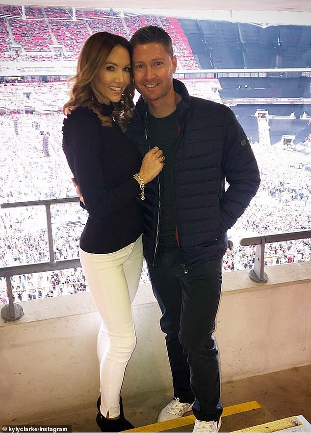 It's over! Michael Clarke (right) moved into an $8million 'bachelor pad' in Bondi after splitting from his wife, Kyly (left), five months ago and leaving their $12million family home in Vaucluse