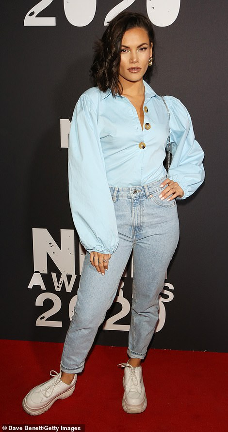 Casual: Singer Sinead Harnett donned a blue long-sleeved shirt tucked into a pair of denim jeans