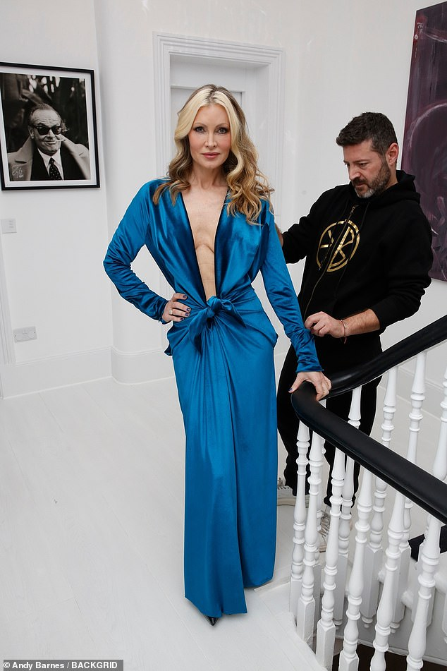Looking good: The stunning blonde, 48, showed off her modelling credentials as she paraded the outfits whilst designers Svetoslav and Emilio ensured they were adjusted