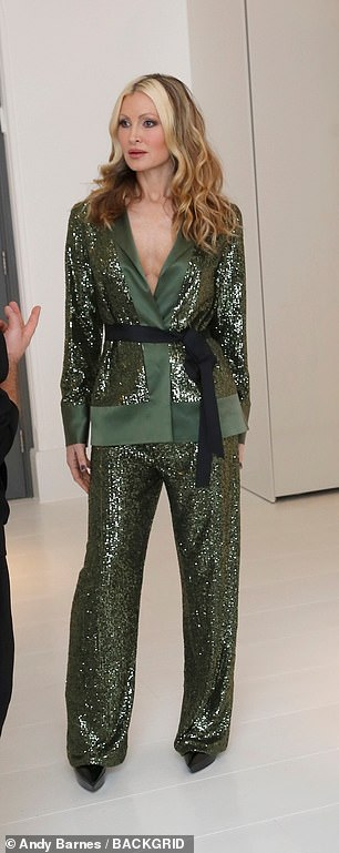 Gorgeous in green: Caprice dazzled in a sequinned moss green trouser suit that skimmed over her lithe frame