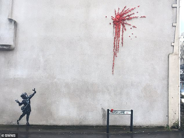 Banksy created a new masterpiece in the spirit of Valentine's Day after a picture of a little girl firing a catapult full of flowers appeared in Bristol