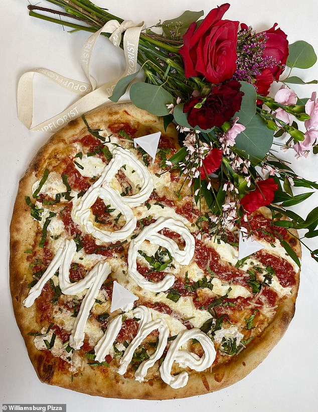 True love: A New York City pizza chain is offering personalized heart-shaped pizzas that come complete with a bouquet of flowers for Valentine's Day