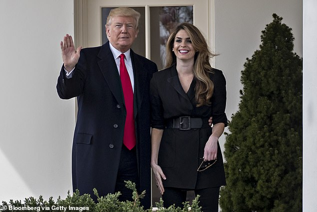 President Trump (left) waves to reporters standing alongside White House Communications Director Hope Hicks (right) in March 2018. She had announced her White House departure a month before. Now she's headed back to the West Wing in a few weeks