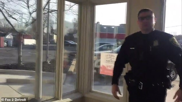 Police are shown in the video arriving to Key Bank, who claim the teller called the police as part of a protection policy for employees that requires customers to remove their masks