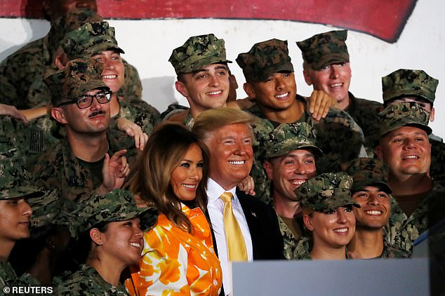 President Trump and first lady Melania Trump took photos with military personnel aboard the USS Wasp, where other sailors were wearing the Make Aircrew Great Again patches