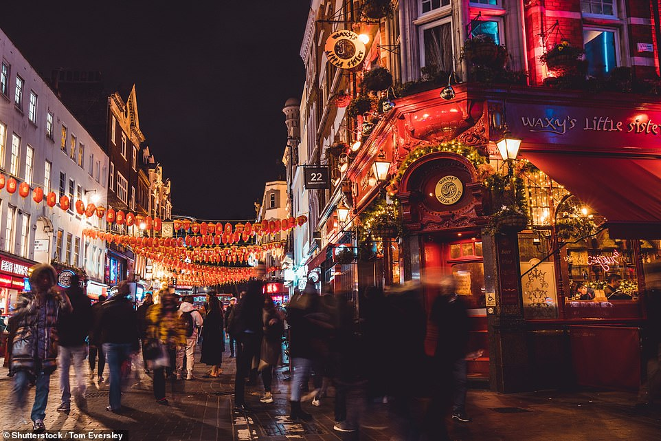 Meanwhile blogger Jex Wang has claimed people on public transport are 'moving away' from those of East Asian origin, leaving her 'anxious' to leave the house. Pictured: China Town was significantly busier in November last year