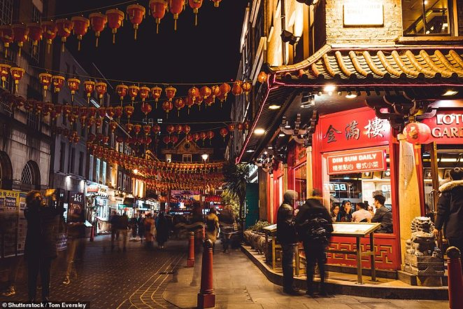 It yesterday emerged that more than 750 British patients were tested for the disease, that originated in Wuhan, China, in one day while 2,512 people have been tested in the country since last month. Pictured: Chinatown had many more visitors in November last year
