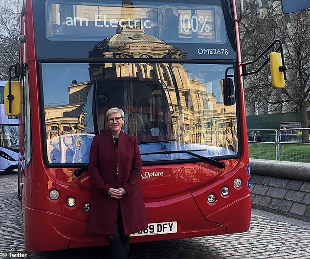 The summit's speakers included Baroness Vere, who posed with an all-electric bus outside the QEII Centre, which is around 100 yards from Westminster Underground Station
