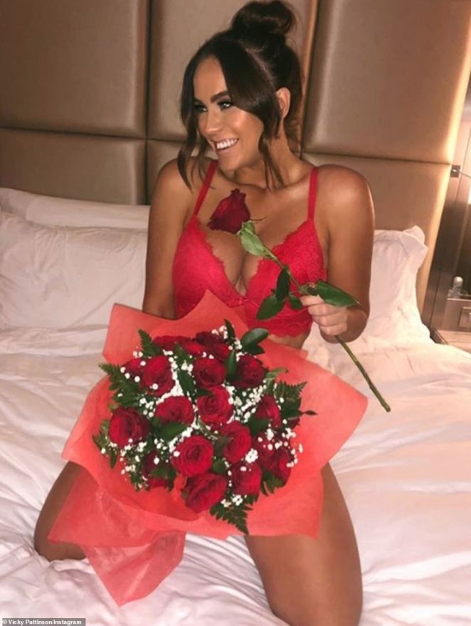 Sizzling:Vicky Pattison, who is dating TOWIE star Ercan Ramadan, was sizzling in red lace lingerie while holding a vast bunch of roses and adding the simple caption: 'Happy Valentines Day Everyone'
