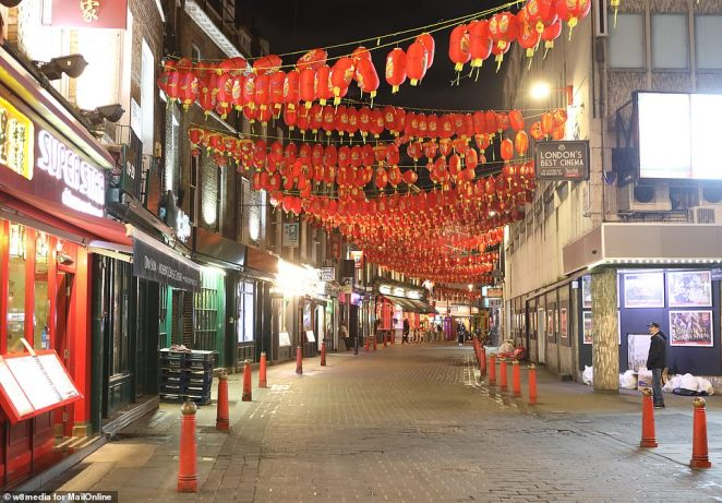 Latest surveys found that 14 per cent of Britons said they would avoid contact with people of Chinese origin or appearance due to coronavirus fears. Pictured: The streets remained almost empty in eerie images taken last night